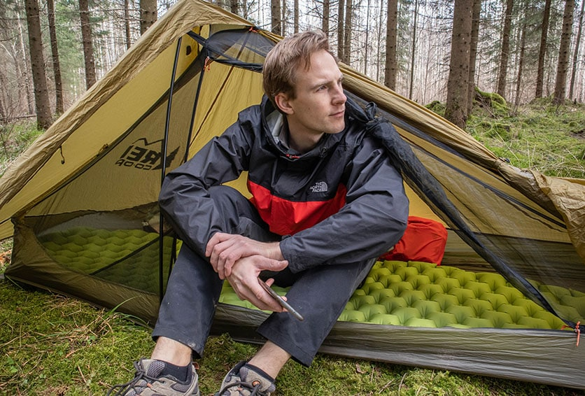 A man sitting in the rei flash air 1 tent