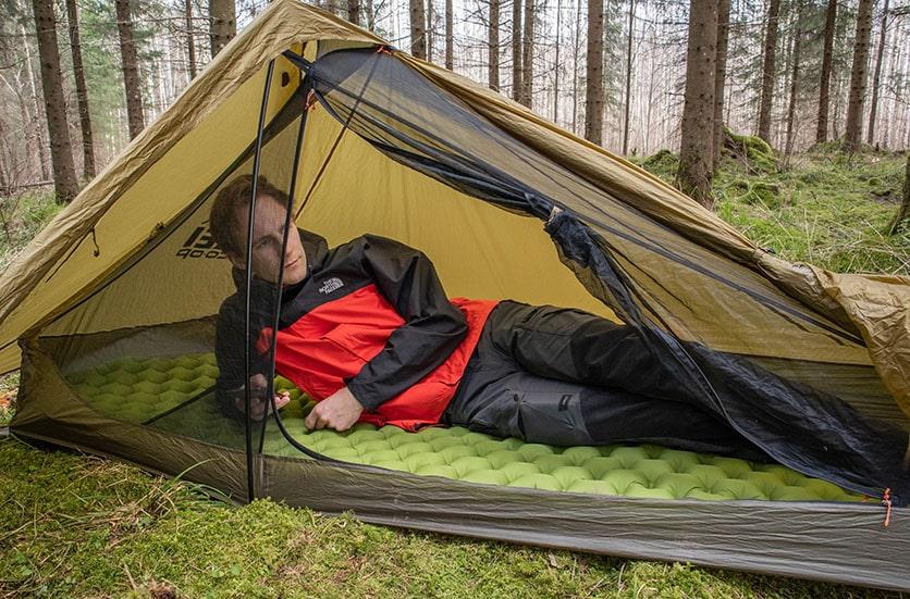A man sleeping in the rei flash air 1 tent