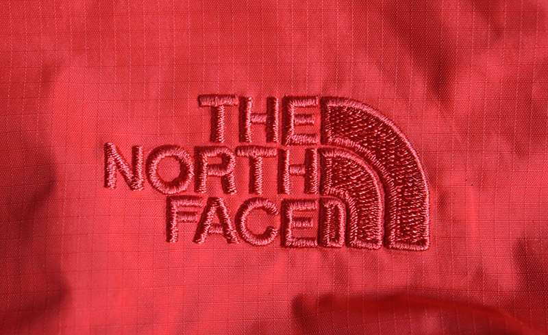 The North Face logo Sewn in the fabric red