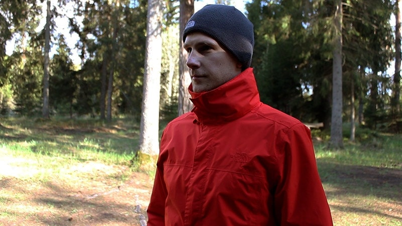 Showing the high collar of the North Face Resolve 2 rain jacket