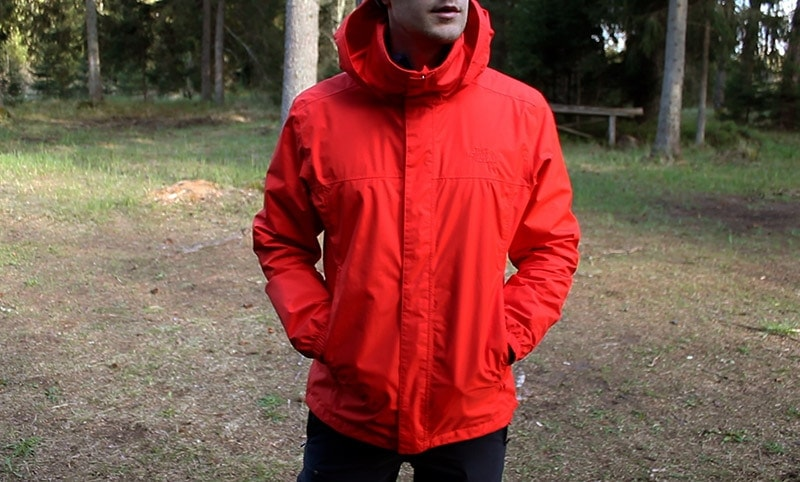 A man wearing the North Face Resolve 2 rain jacket with hands in pockets