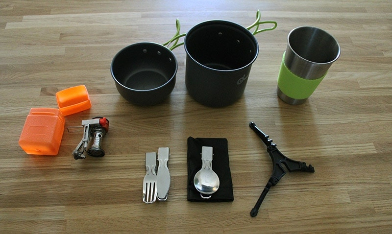 Full Odoland camping cookware set laid out on a table